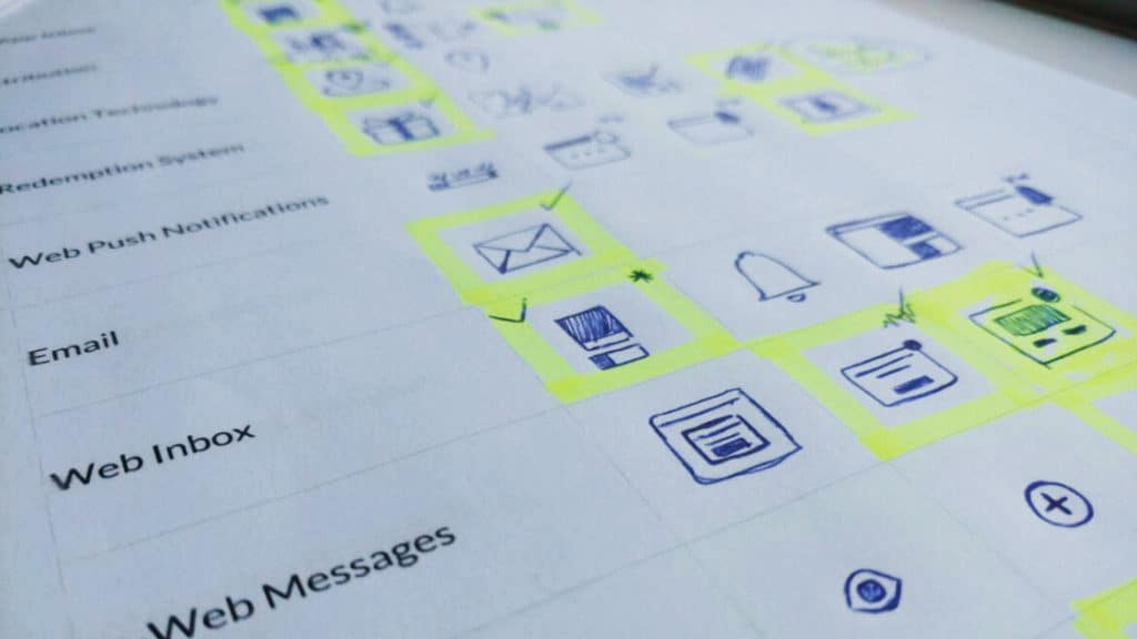 Image of sketched icons on a paper grid